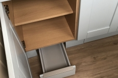 Shelved unit with plinth drawer below
